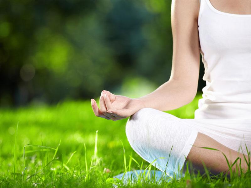 women doing yoga on grass